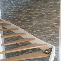 """Referensjobb """"Fondvägg i trappa/hall."""" utfört av JB-JH Bygg & Kakel AB"""